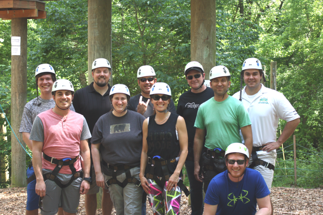 Red Arch employees enjoy ropes course.